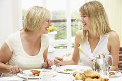 Two Women Enjoying Hotel Breakfast - stock photo