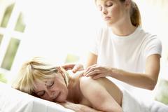 Middle Aged Woman Enjoying Massage - stock photo