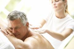 Middle Aged Man Enjoying Massage - stock photo