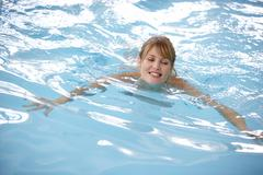 Young Woman Swimming In Pool - stock photo