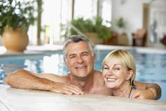 Middle Aged Couple In Swimming Pool Stock Photos