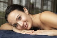 Young Woman Relaxing On Massage Table - stock photo