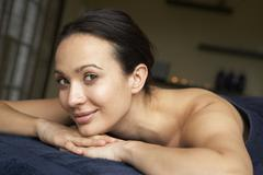 Young Woman Relaxing On Massage Table Stock Photos