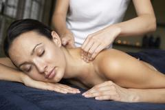 Young Woman Enjoying Massage - stock photo