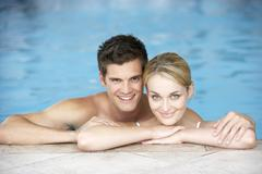 Young Couple Swimming In Pool Stock Photos