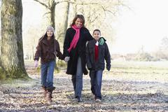 Mother And Children On Autumn Walk Stock Photos