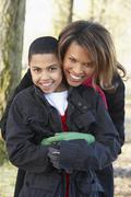 Mother And Son On Autumn Walk - stock photo