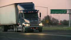 Close up of Big Rig Truck passing from shoulder of Freeway along Interstate 5 HD Stock Footage