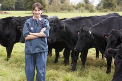Portrait Of Vet In Field With Cattle Stock Photos