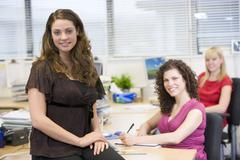 Women working happily in an office - stock photo