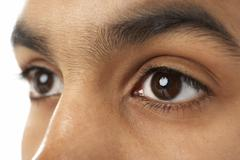 Close-Up Of Young Boy's Eye - stock photo