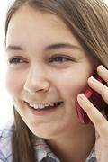 Young Girl Talking On Mobile Phone Stock Photos