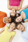 Overhead View Of Five Young Children In Studio - stock photo