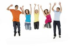 Stock Photo of Group Of Five Young Children Jumping In Studio