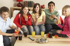 Group Of Children Eating Burgers At Home Stock Photos