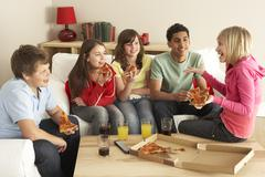 Group Of Children Eating Pizza At Home - stock photo