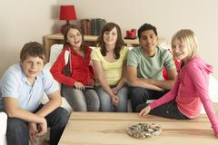 Group Of Children Watching TV At Home Stock Photos