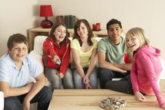 Group Of Children Watching TV At Home - stock photo