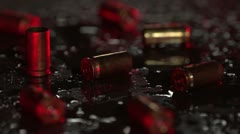 9 mm bullet casings on the ground with flashing lights on a rainy night. Stock Footage