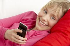 Young Girl Reading Text Message Stock Photos