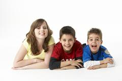 Brothers And Sister In Studio - stock photo