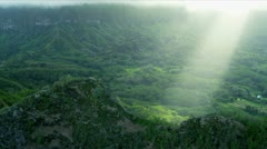 Aerial view of sun rays on volcanic cliffs, Hawaii Stock Footage