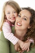 Portrait Of Cuddling Mother And Child - stock photo