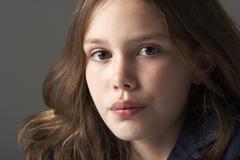 Thoughtful Girl Sitting In Studio - stock photo