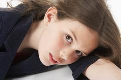 Thoughtful Girl Sitting In Studio - stock photo