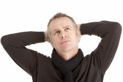 Stock Photo of Portrait Of Thoughtful Middle Aged Man