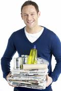 Stock Photo of Man Carrying Stack Of Recycling
