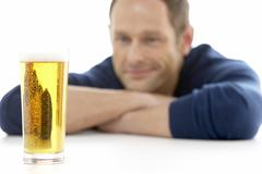 Man Looking At Glass Of Beer Stock Photos