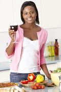 Woman Enjoying Glass Of Wine In Kitchen Stock Photos