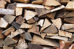 firewood stack closeup - stock photo