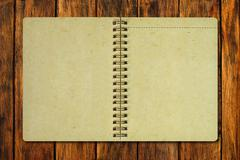 Brown recycle paper notebook on wood Stock Photos