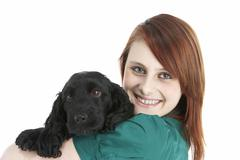 Girl With Black Spaniel Puppy - stock photo