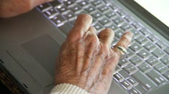 Elderly man's hands typying on laptop MED Stock Footage