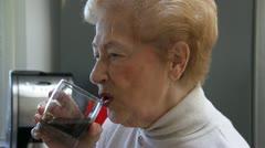 Elderly woman dislikes taking medication - stock footage