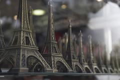Models Of Eiffel Tower In Shop Window Stock Photos