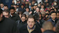 Morning commuters crowd of people walking going to work slow motion Stock Footage