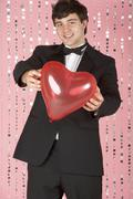 Young Man Dressed In Suit Holding Heart Stock Photos