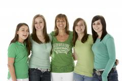 Group Of Teenage Girls With Mother - stock photo