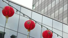 Chinese lanterns over glass and steel buildings Stock Footage