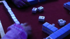 A group of people playing mahjong Stock Footage