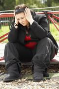 Young Woman Sitting In Playground - stock photo