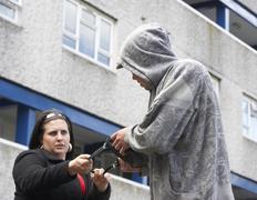 Man Mugging Woman In Street - stock photo