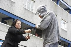 Man Mugging Woman In Street Stock Photos
