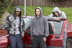 Group Of Young Men With Cars - stock photo