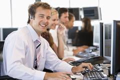Stock Trader Smiling At Camera - stock photo