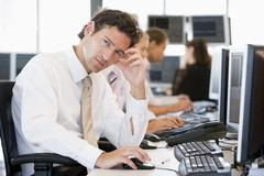 Stock Photo of Stock Traders Working At Computers